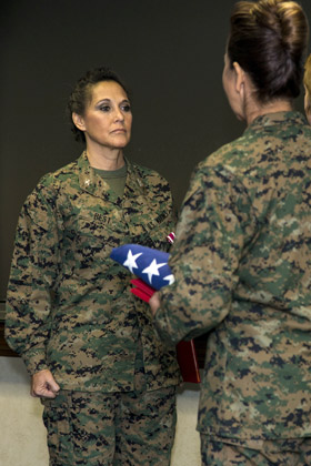 Colonel Annita Best, left, assistant deputy public affairs, Marine Corps Installations East, stands at the position of attention during her retirement ceremony, Camp Lejeune, N.C., Dec. 30, 2016. Best retired after 30 years of honorable and faithful service. (U.S. Marine Corps photo by Cpl Judith L. Harte)